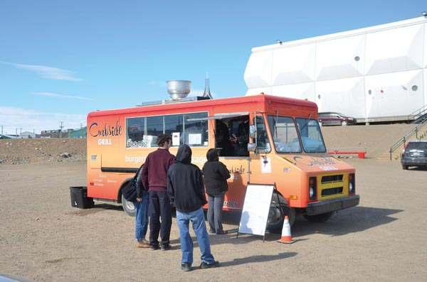 Curbside Grill sets up shop outside the Baffin Gas Bar in Iqaluit and offers residents menu items made from scratch daily. Photo Peter Thuell