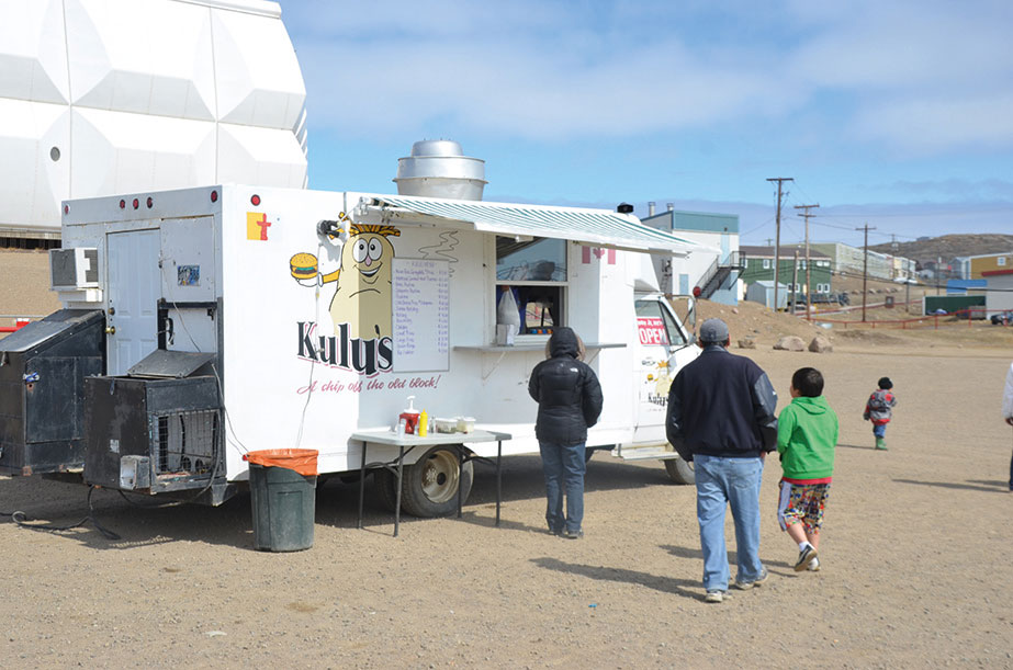 You'll find Kulu's in front of Nakasuk School during the day, and outside the Legion late at night catching the after-bar crowd. Photo Peter Thuell