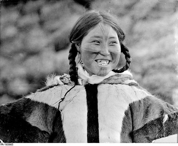 Kila, photographed near Victoria Island in 1916, wears typical designs found near the Coronation Gulf. George H. Wilkins/Library and Archives Canada/PA-165665