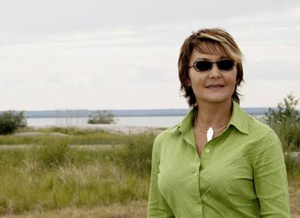 Suzan Marie stands on the shore near Behchoko