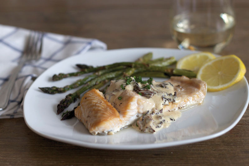 Baked trout with morel cream sauce and roasted asparagus. Photo by Amy Lam