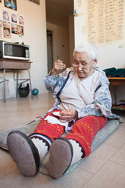 83-year-old Victoria Mangosvaluk Kayuryuk stitches in her home. Baker Lake has a thriving and renowned arts scene. Photo by Hannah Eden