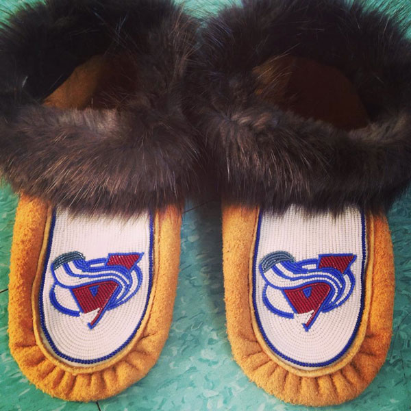These custom beaded moccasins pay tribute to the Colorado Avalanche. Photo courtesy of Ashton Semple