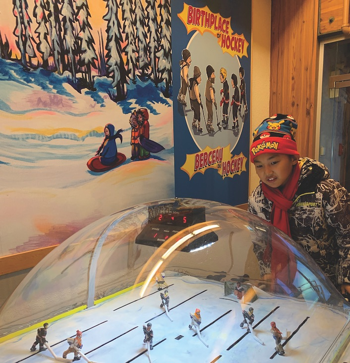 Kobe Hsu learns hockey's alleged origin at the Prince of Wales museum in Yellowknife.