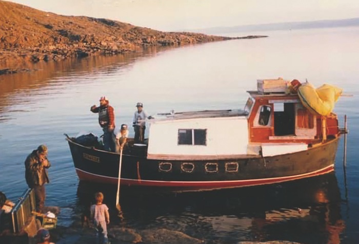 A crew aboard the Esoterica, a Minna lifeboat turned pleasure craft in the '80s. COURTESY Bill Barnie
