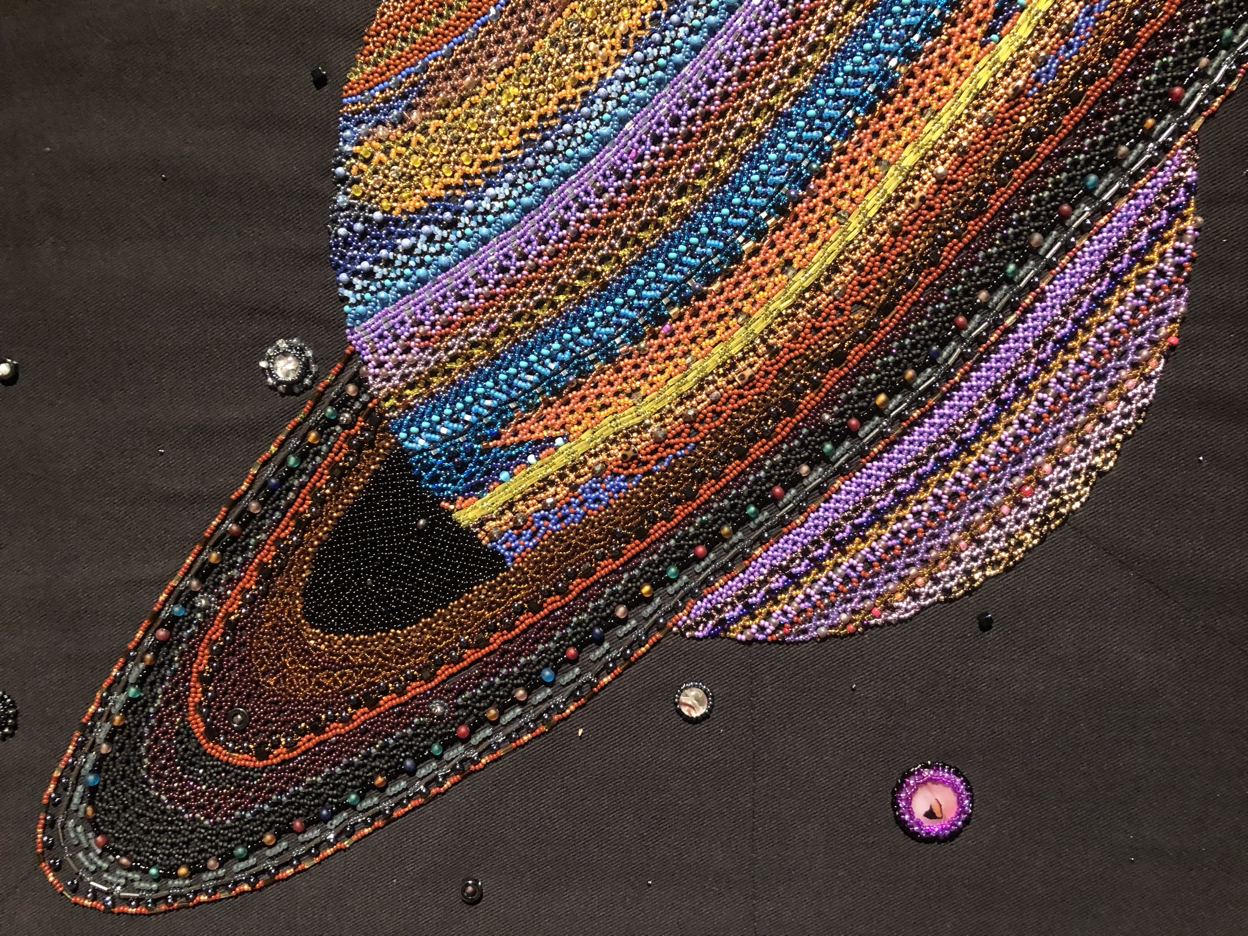Saturn (detail), Beadwork on canvas, 29x26 in, by Margaret Nazon. Courtesy PWNHC
