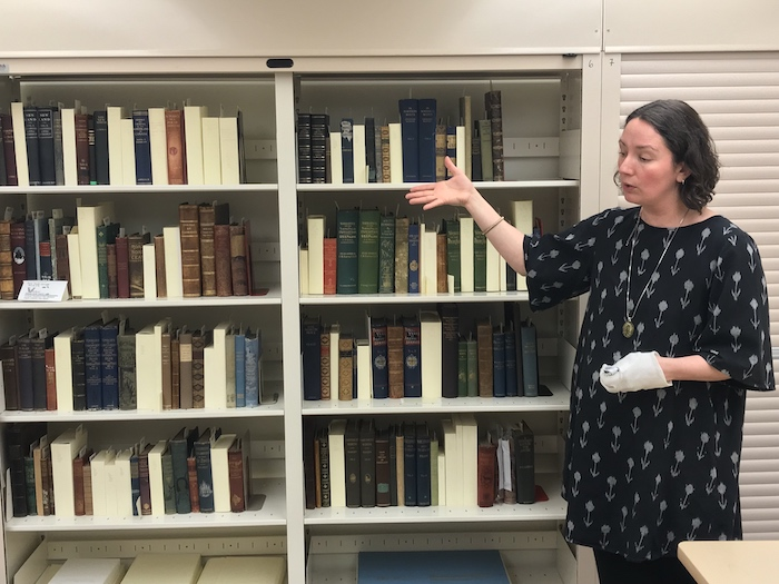 Archivist Erin Suliak shows off the centre's rare book collection. Like many rooms containing old and valuable materials, temperature and humidity here are carefully controlled.