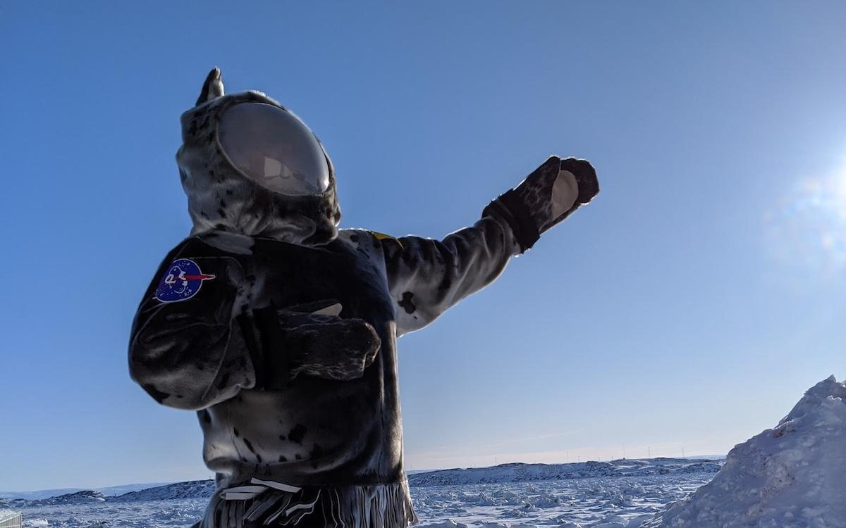 qaluit artist Jesse Tungilik blasts off in his sealskin spacesuit.