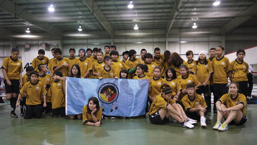 Fort Liard players joined forces with a team from Behchoko, NWT, to compete in Edmonton in 2012. Photo by Ollie Williams