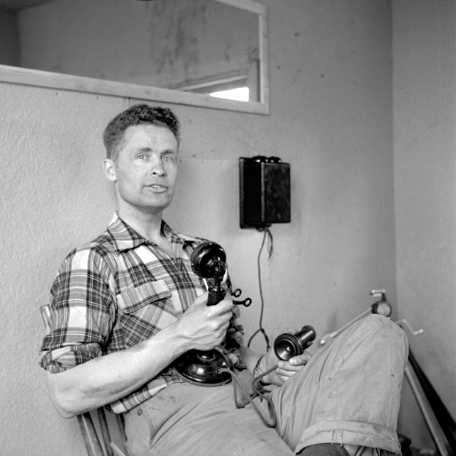 Max Ward sits in his Yellowknife office in the early 1950s. NWT Archives/Henry Busse Fonds/N-1979-052:3789