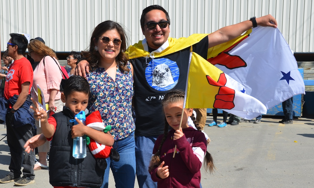 Amber Giles, Nastania Mullin, Meegwun Giles and Mason Mullin champion the Nunavut flag. PHOTOS BY BETH BROWN