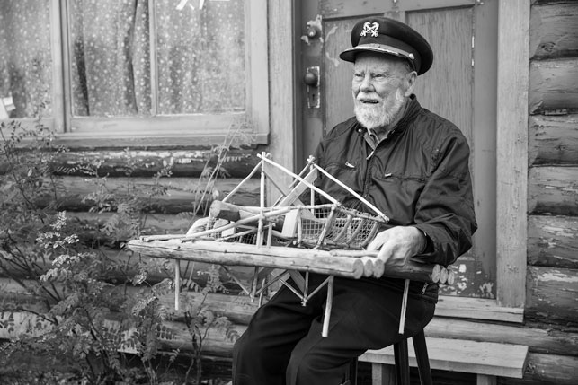 Over the years, Jim Robb himself has become one of the territory's enduring characters. And he's befriended many others. Here is Captain Dick Stevenson, the man behind Dawson City's infamous Sourtoe Cocktail, holding a replica fish wheel he built many yea