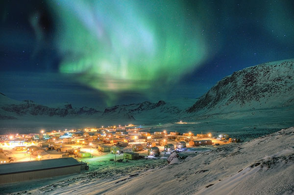 Pangnirtung, lit up by the aurora borealis. CREDIT MICHAEL H. DAVIES