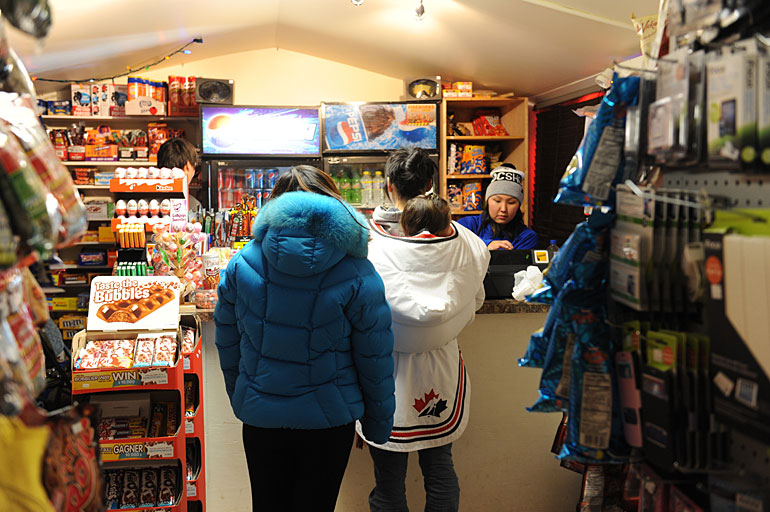 Two women buy some necessities at Dis and Dat Convenience. Photo by Herb Mathisen
