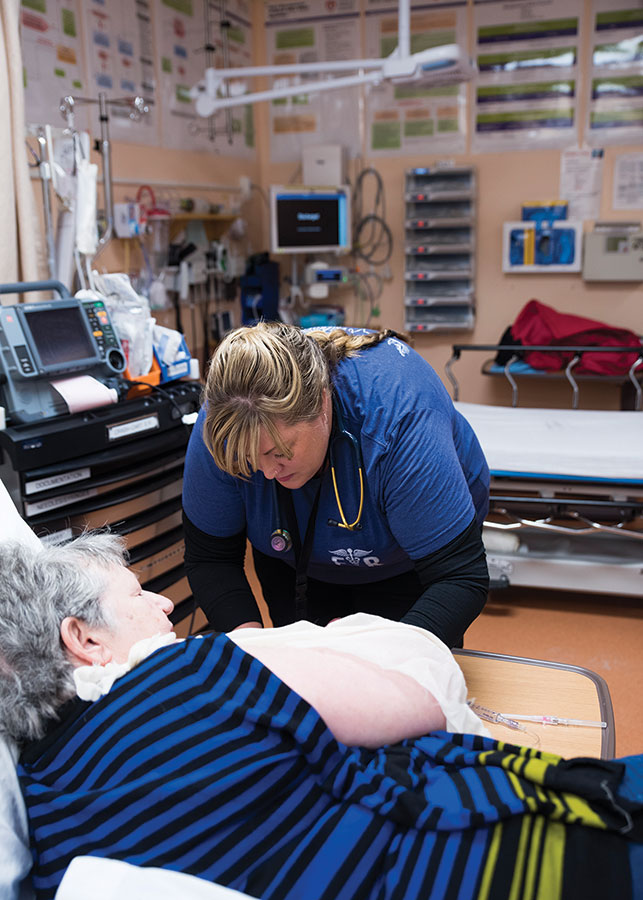 Registered nurse Stephanie Weatherby treats patient Peggy Jenkins in Yellowknife's Stanton Hospital ER. Photo by Pat Kane.