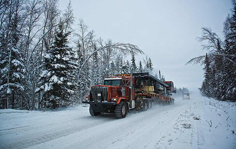 Truck driving is not just a job on the winter road. Listening in on the sat phone, we're privy to a whole community, with a lingo of its own. Photo by Angela Gzowski