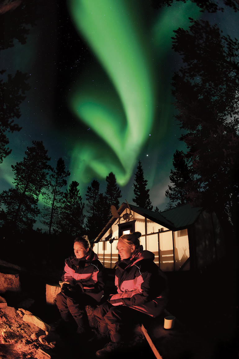 Northern lights hang over Northern Tales' trading post, near Whitehorse