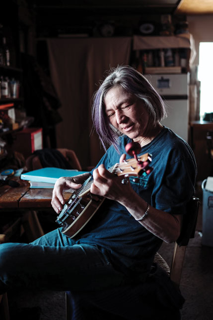 Janet Boxwell unwinds from a busy week by playing some banjo. Photo by Weronika Murray