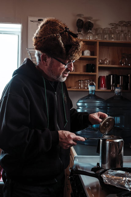 "Hans Maurer makes breakfast and morning coffee. The retired chef's ""cabin gourmet"" meals are legendary. Photo by Weronika Murray"