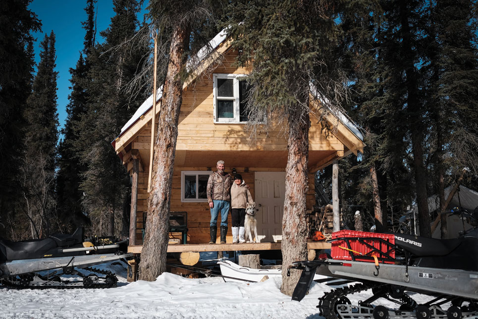 Randy Zerke, Marsha Day and dog Dempster. With the prohibitive costs of travel, owning a cabin is the cheapest way to get a break from town, Day says. Photo by Weronika Murray