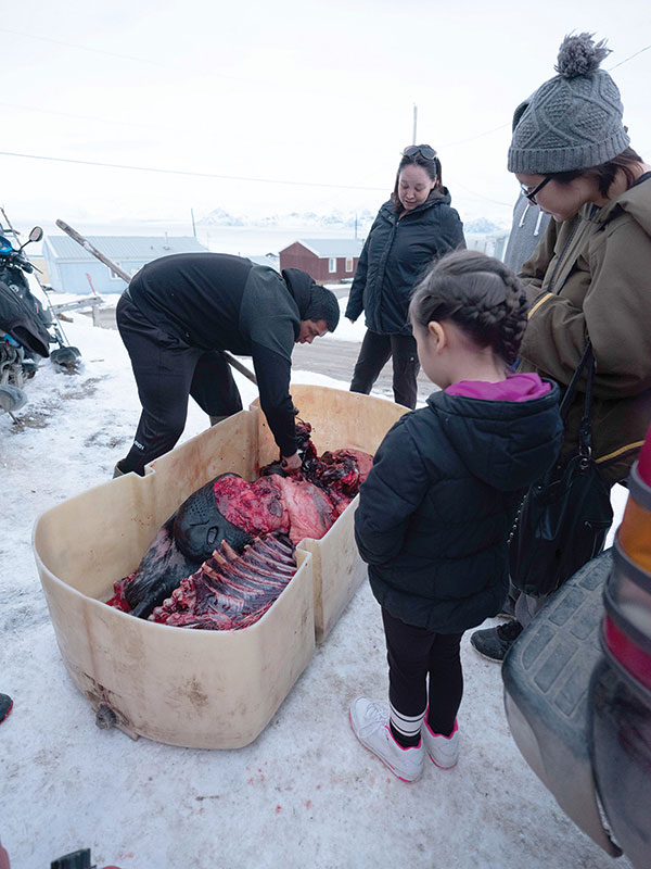 People in town came out to take a look at the massive hooded seal Jaworenko and his brother brought back from a hunting trip.