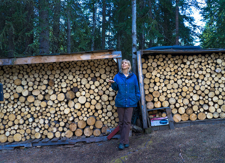 Sgaga used to haul wood with her dogs. Now she pays for lengths, though she cuts and splits it herself. Photo by Chris Healey