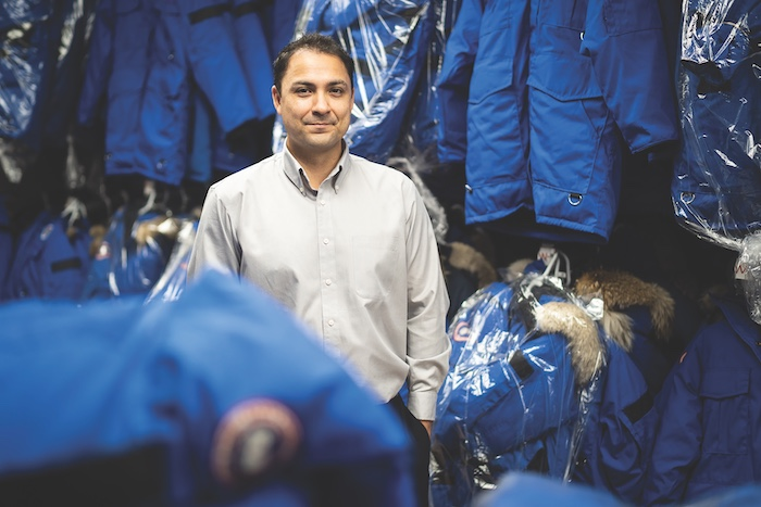 Mike Morin, CEO of Aurora Village, stands among the parkas at the company's downtown Yellowknife headquarters. The parkas represent a $600,000 investment by the company.