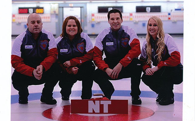 The NWT's 2015 Mixed Curling team (from left, Jamie, Kerry, Robert Borden, and Megan Koehler). Courtesy of the Koe family.