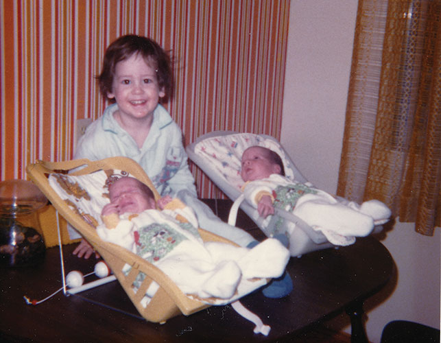 A two-year-old Kevin Koe with his twin siblings, Jamie and Kerry. Courtesy of the Koe family.