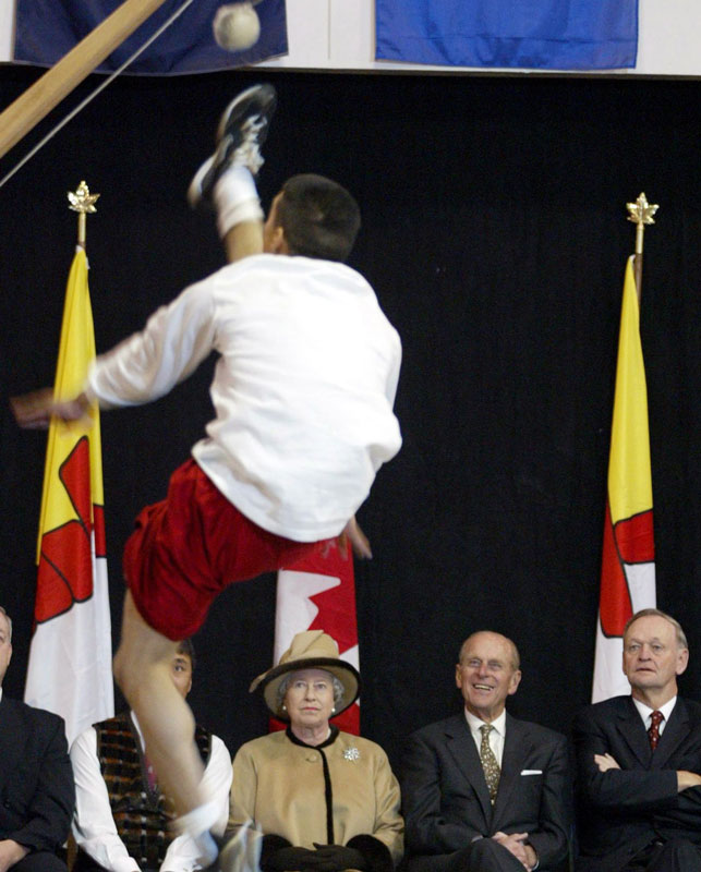 Queen Elizabeth II, Prince Philip and then-prime minister Jean Chretien take in a high kick demonstration during the Royals' 2002 visit to Iqaluit. Photo Jonathan Hayward/CP Images