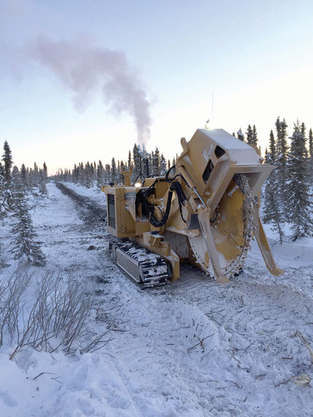 Cutting the line: a T555 saw breaks ground on the Mackenzie Valley Fibre line to Inuvik. COURTESY LEDCOR