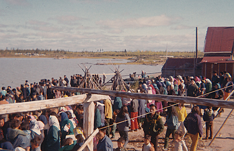 The people of fort rae gather to welcome home the hunters. Photo by Roger Brunt