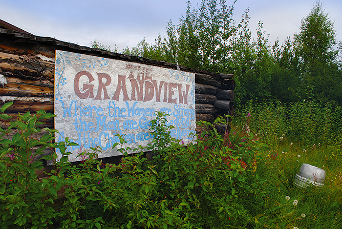 Weeds threaten to overcome the Grandview sign and its promises of greatness. Photo by Kristine Bourque