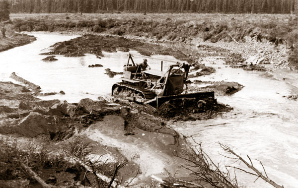 A worker operates a bulldozer in 1942 along the soon-to-be Alaska Highway on the outskirts of Whitehorse. (Yukon Archives/Whitehorse Star Ltd.)