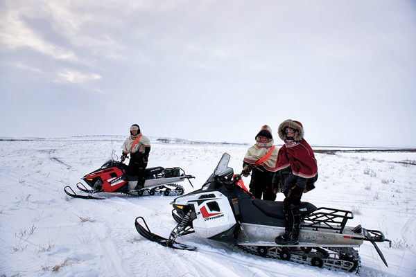 Today's reindeer herders have snowmobiles and SPOT devices at their disposal when bringing the herd from Richards Island, across the Mackenzie River, to Jimmy Lake each winter. Photo courtesy of Jason Van Bruggen/NWTT