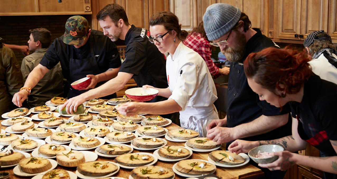 Chefs plate a meal at Yukon chef Carson Schiffkorn's Inn on the Lake during the 'Across the Top of Canada' culinary tour last June. Courtesy Edible Canada