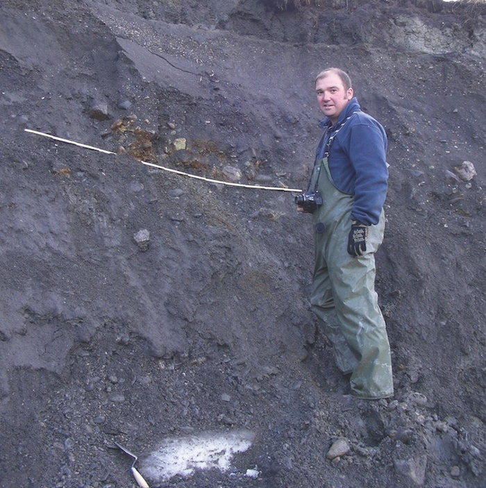 MacKay stands by the headwall of the thaw slump where remains were discovered.