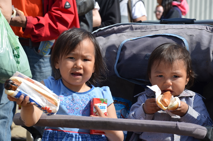 Star, 3 and Zack, 2, were early in line for a Nunavut Day hot dog.