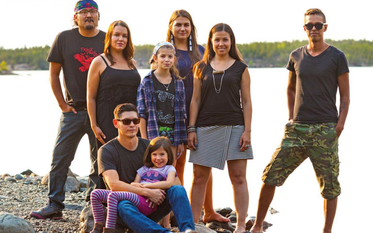 Left to right: Dëneze Nakehk'o, Nina Larsson, Maslyn Scott, Tania Larsson, Kyla Kakfwi Scott, Eugene Boulanger. In front: Amos Scott with Sadeya Scott. Photo: Hannah Eden/Up Here