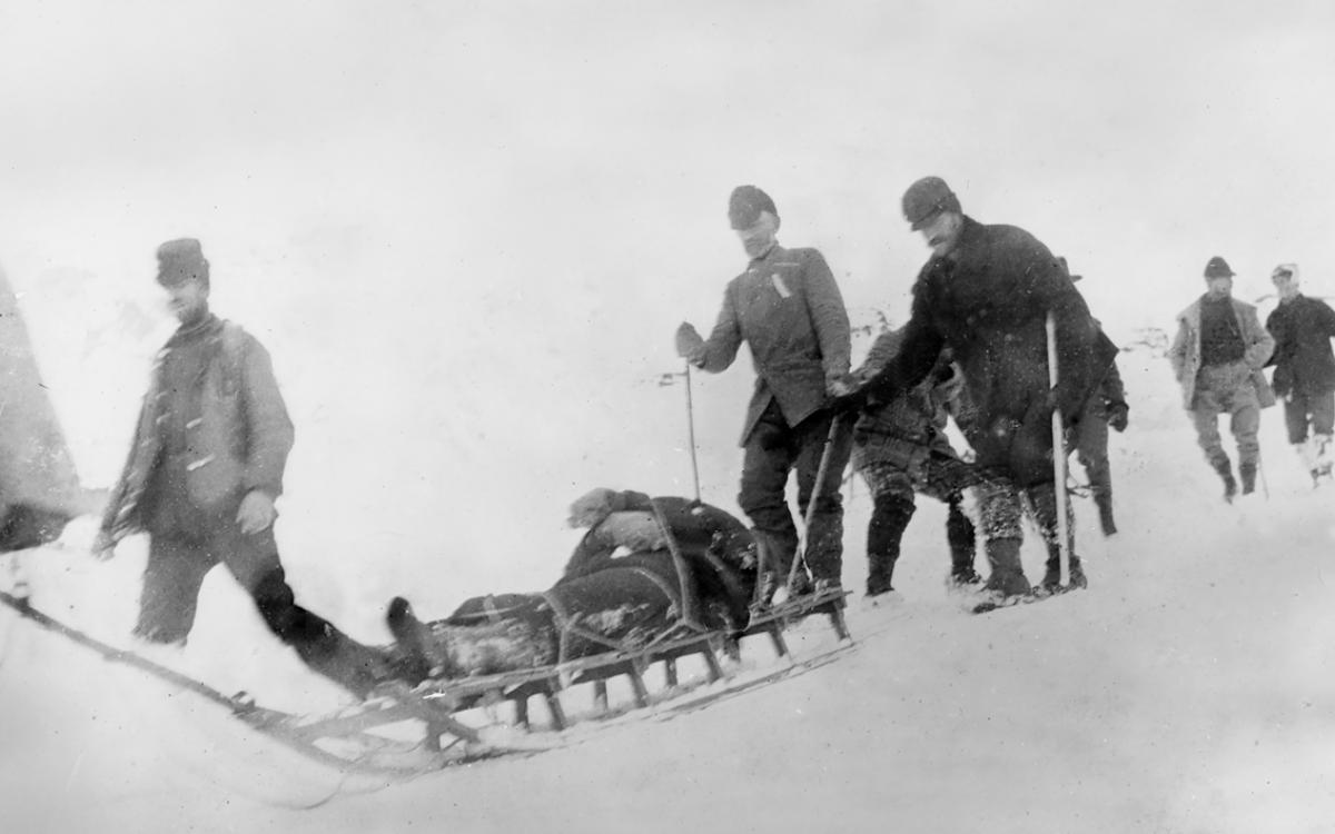 Bringing out the dead: hauling bodies by sled from the summit of the pass, April 3, 1898. Yukon Archives, Anton Vogee Fonds, #71
