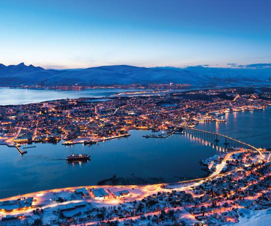 Does this look like the Arctic to you? Tromsø, Norway, north of the 69th parallel, has become a bustling university and port town.