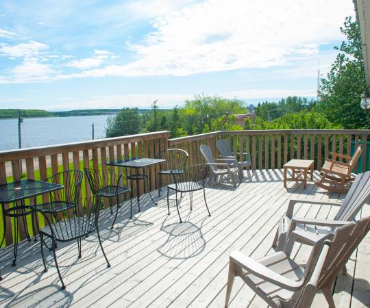 The front deck of the Mackenzie Rest Inn overlooks the mighty Mackenzie River. Photo by Herb Mathisen/Up Here