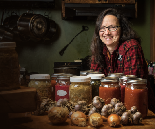 CAN-DO ATTITUDE: Dawson City filmmaker Suzanne Crocker with the fruits—and veggies, and jams, and sauces—of her labour. On July 31, 2017, Crocker began an ambitious project to go one year eating only what could be found or foraged around the Yukon town.