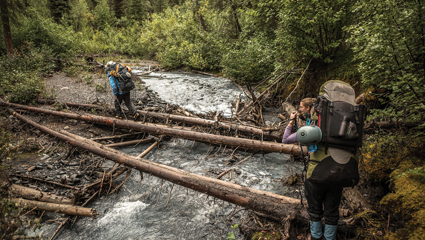 The author, upper right, prepares to cross a river in Nahanni National Park. Photo by Gary Bremner