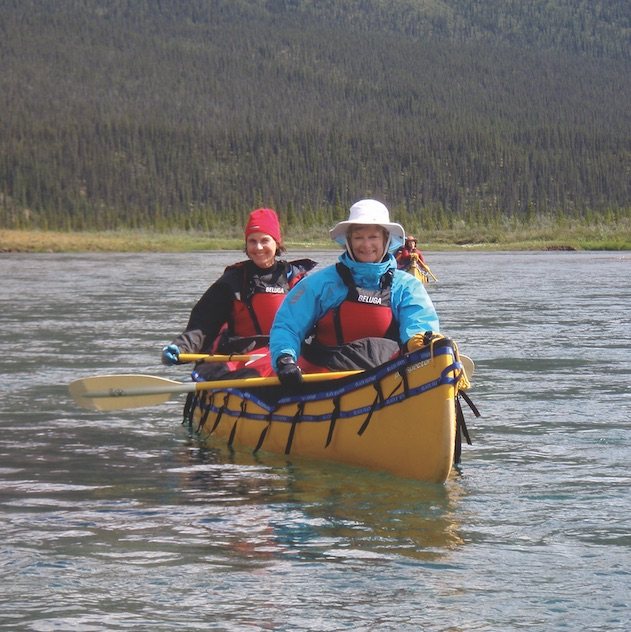 Paddling with one of Black Feather's all-women canoe tours. Courtesy Black Feather