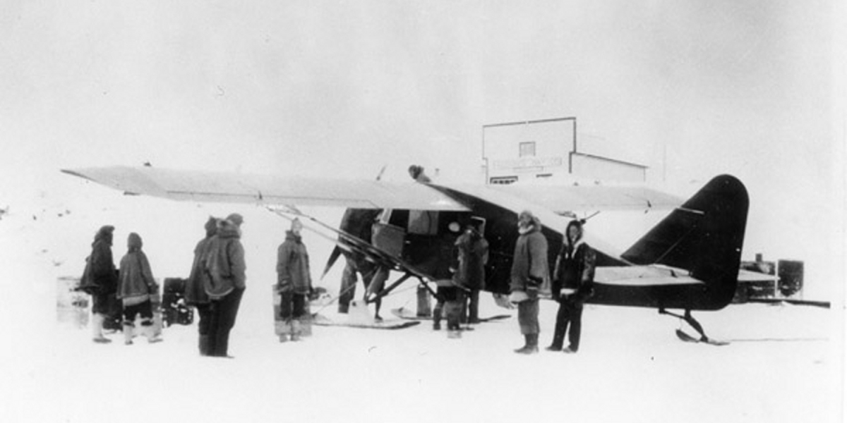 Wop May loading his airplane in Aklavik, NWT, during the hunt for the Mad Trapper in 1932. Public Domain